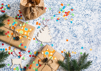 Holiday background. Homemade christmas gifts and decorations on light background. Top view, flat lay.