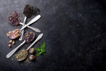 Assortment of dry tea in spoons