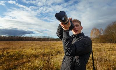 young photographer shoots nature landscape