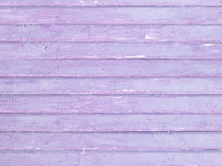 Vintage wood wall background with violet peeling paint