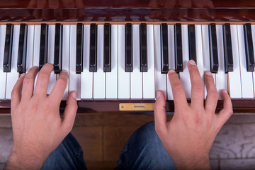 Man playing piano with both hands closeup2