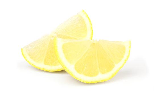 Two wedges of fresh lemon on white background