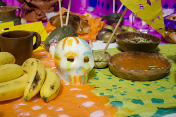 Bananas and sugar skull. Part of a mexican day of the dead offering altar