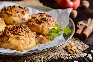 Baked apple with oatmeal, walnuts, honey and cinnamon