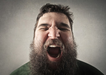 Bearded man screaming