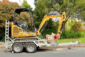 excavator on trailer for transportation