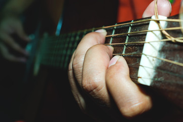 playing acoustic guitar close-up