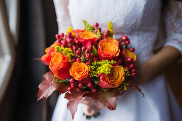 Bride holding wedding Colorful bouquet of autumn flowers