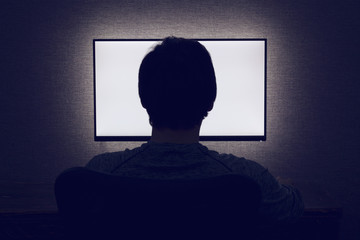 Man in front of a blank monitor