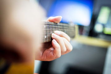 playing acoustic guitar close-up soft focus