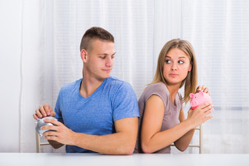 Young couple is hiding savings from each other.
