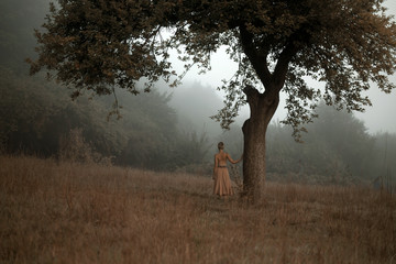 girl at lonely tree