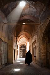 Woman in Veil Passing through Grand Old Bazaar of Yazd