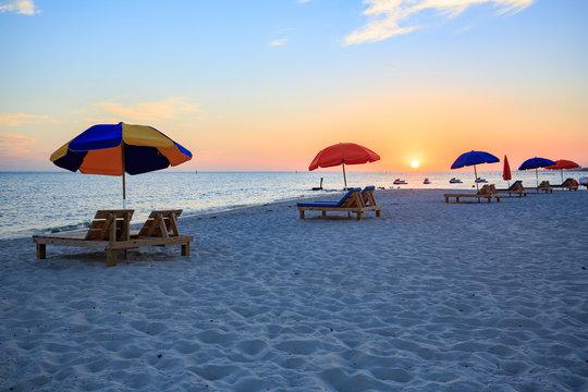 Sunset in Biloxi beach, with umbrella for tourist, Mississippi, along Gulf Coast shore