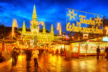 Traditional christmas market with 'Merry Christmas' sign in Vienna, Austria