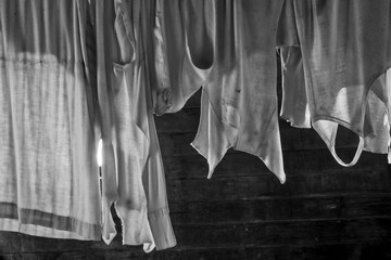 Old dusty laundry hangs on a clothesline in the historic Thomas-Noteware home in Coloma, California.