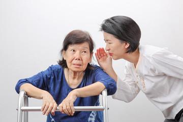Asian seniors woman hearing loss , Hard of hearing