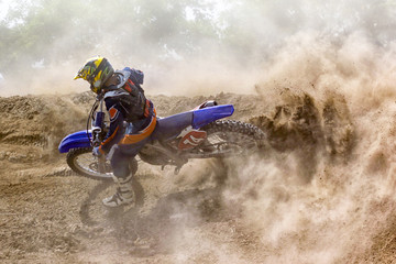 Motocross rider creates a large cloud of dust and debris Wall mural