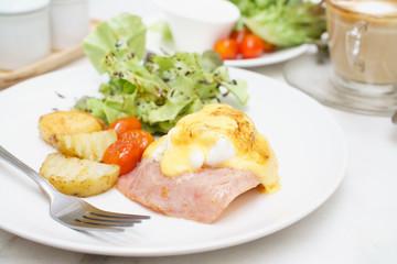 Egg benedict ham on toast breakfast with coffee