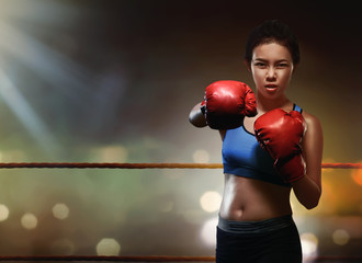 Beauty asian woman boxer with red boxing gloves