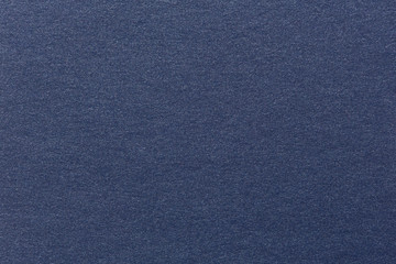 Photograph of navy blue striped pastel paper, coarse grain grung