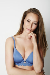 Brown eyed babe in blue bra, portrait