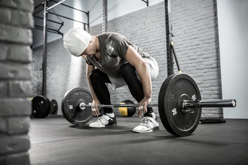 Man's crossfit workout with barbell