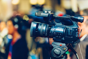 TV camera on event. TV camera recording event