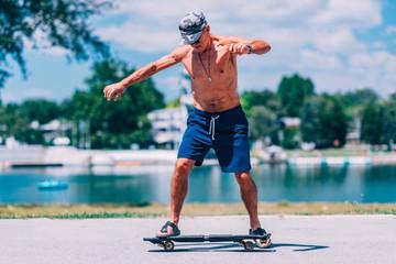 Senior skateboarder. Senior male on skateboard