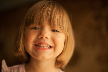 Cheerful smile of the lovely baby girl