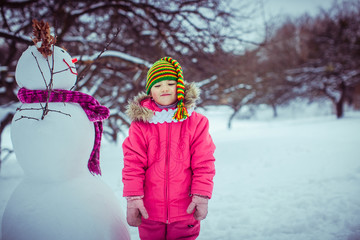 Funny girl with the nice snowman