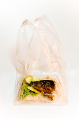 Grill fish on rice in plastic box, Take home food