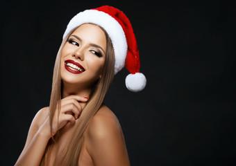 Beautiful woman portrait with Santa's hat, beauty on dark background
