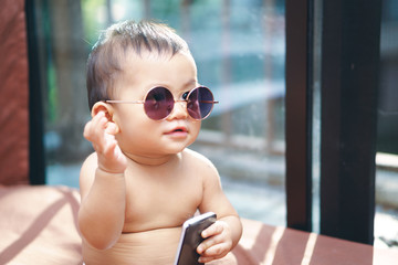 Asian baby wearing glasses
