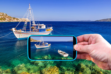 Making photos by smartphone of greek coastline