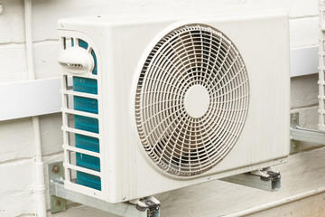 Weathered White Airconditioning Unit Mounted on Exterior Home Wa