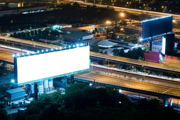 Blank billboard night scene on the highway in city