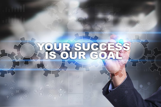 Businessman is drawing on virtual screen. your success is our goal concept.