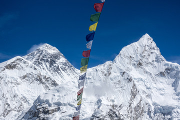 Beautiful Landscape of  Everest and Lhotse peak with colorful Nepali flag from Kala Pattar view point. Gorak Shep. During the way to Everest base camp. Sagarmatha national park. Nepal.