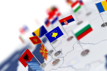 Kosovo flag in the focus. Europe map with countries flags