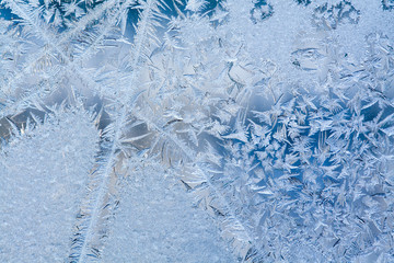 Ice flowers and frozen dirty window macro view. Frost texture pattern. Winter scene. soft focus photo
