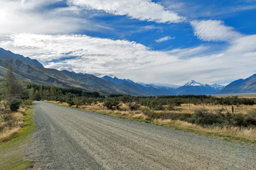 Gravel road to campsite at Glentanner Park Centre with Aoraki / Mount Cook seen in background