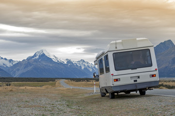 Motorhome on Mount Cook Road (State Highway 80) along the Tasman River leading to Aoraki / Mount Cook National Park and the village