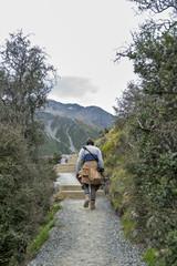 A man taking photo along the walking trail to the Blue Lakes and Tasman Glacier View, Aoraki / Mount Cook National Park