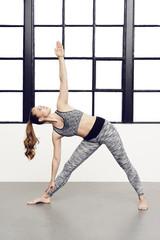 Beautiful woman in yoga pose, studio