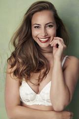 Beautiful woman in white bra, portrait