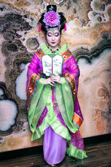 Chinese woman in traditional dress with fan
