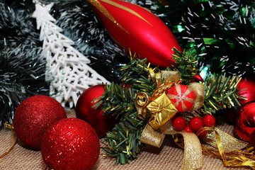 Different, beautiful and unusual Christmas decorations on a colorful background