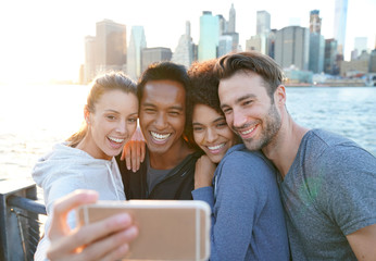 Friends taking selfie picture on Brooklyn heights promenade, NYC
