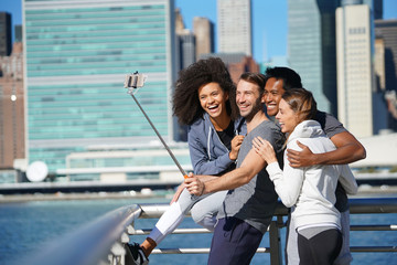 Group of friends taking selfie picture, Manhattan in background